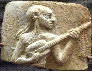 Egyptian Artist 3,500 years old playing a guitar-like instrument