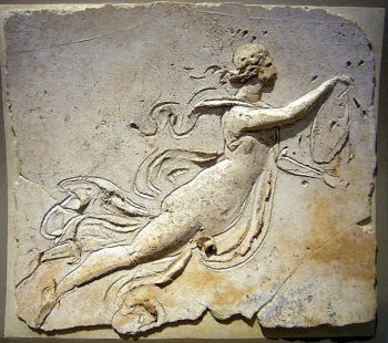 Stucco relief of a maenad holding a tympanum