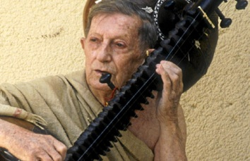 Alain Daniélou playing sitar, 1987
