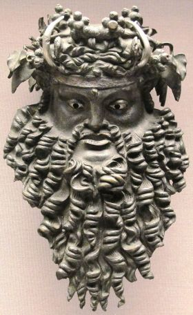 Bronze mask depicting Dionysus bearded and horned, 200 BC – 100 AD